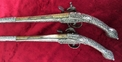 Balkan or Greek Miquelet pistols. The solid stocks covered with silvered decoration. Ref 9000   Muzzleloader