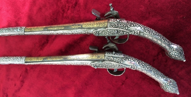 Balkan or Greek Miquelet pistols. The solid stocks covered with silvered decoration. Ref 9000 Pistol / Hand Guns