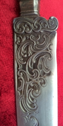 A very unusual silver mounted hunting knife.  Blades