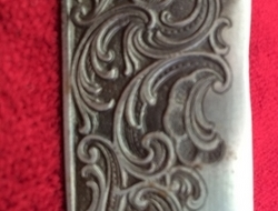 A very unusual silver mounted hunting knife.  Swords
