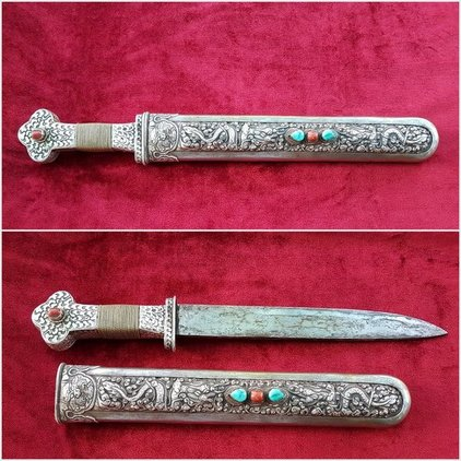 A VERY RARE TIBETAN SILVER COVERED DAGGER. SCABBARD INLAID WITH  CORAL & TURQUOISE STONES. 17 INCHES. Good condition. Ref 9823. Blades