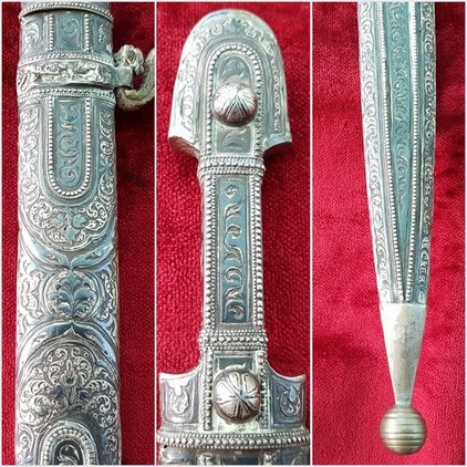 A fine Russian Kindjal the hilt and scabbard covered in nielloed silver  mounts. Good condition. Ref 9825. Blades