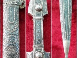 A fine Russian Kindjal the hilt and scabbard covered in nielloed silver  mounts. Good condition. Ref 9825. Swords