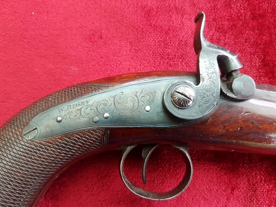 A scarce Irish single shot percussion pistol with Octagonal barrel and a Captive Ramrod. Engraved W. RIGBY, DUBLIN. Good condition. Ref 9584. Pistol / Hand Guns