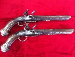 A Fine Pair of Silver metal Mounted Turkish Flintlock Pistols, circa 1800. Silve wire inlaid stocks. Good condition. Ref 6492.   Muzzleloader