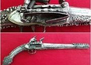 A very long Balkan or Greek Miquelet Flintlock pistol. Elaborate silver decoration. Rat-tail shaped butt. Early 19th century. Ref 8989.   Muzzleloader