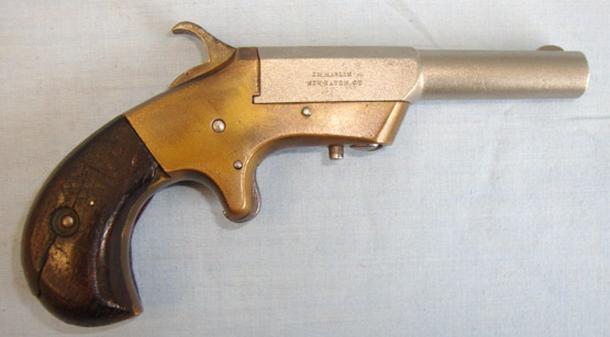 Marlin 'OK' Model .30 Rim Fire Calibre, Brass Frame Swivel Barrel Single Shot Derringer Pistol / Hand Guns