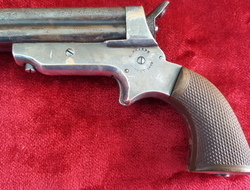 American 4 barrelled derringer marked on the frame