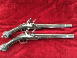 Pair of Balkan flintlock pistols. The stocks covered with silver ...